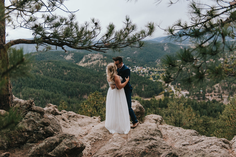 Alex and Brittany after they married themselves on the top of a mountain. Self-solemnization is honored in Colorado, which is why this is one of the best places to have a destination hiking elopement.