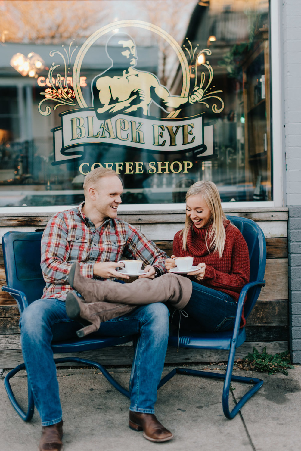 Jordan and Kristen outside of Black Eye Coffee in Denver Colorado. They decided to pose in the blue chairs outside of the coffeeshop during their engagement session.