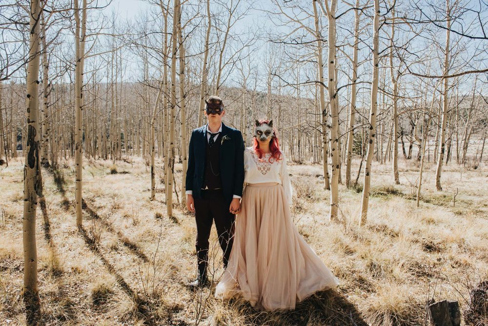 Bride and Groom wearing masks on their wedding day during their Kenosha Pass photo shoot. I love what they wore for their Kenosha Pass destination elopement.