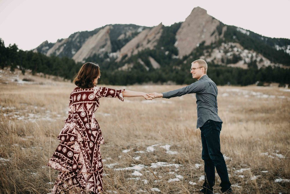 Trinity and Peter dancing in the foothills of Colorado during their Chautauqua Engagement Session.