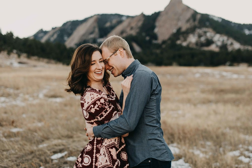 Trinity and Peter during their Colorado hiking engagement session. I love the flatirons in the background of this image!