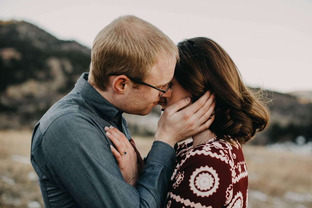 Trinity and Peter sharing an intimate kiss during their couples adventure session at Chautauqua in Boulder, Colorado.