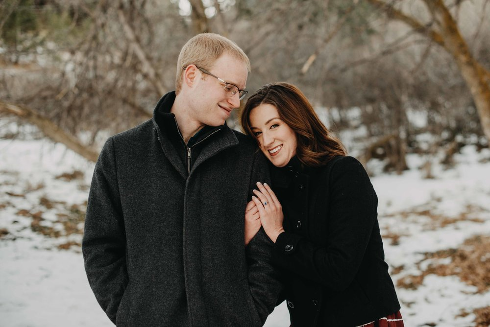 Trinity leaning on Peter during their snowy engagement session in Chautauqua, which is located in Boulder. They flew in from Houston to have some fun in the snow for their couples portraits!