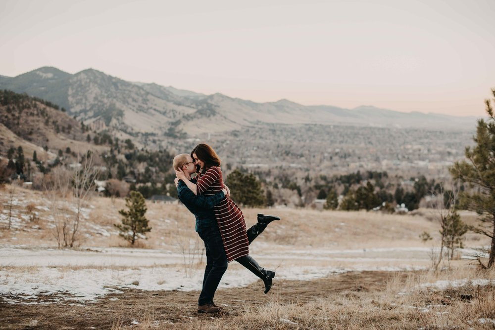 Trinity and Peter embracing. You can see Boulder in the background, as they decided to have their engagement session at Chautauqua during the holidays!