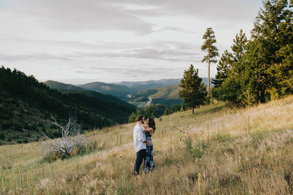 Nicole and Jamie dancing slowly during sunrise on Mount Falcon. The views in this field are gorgeous!