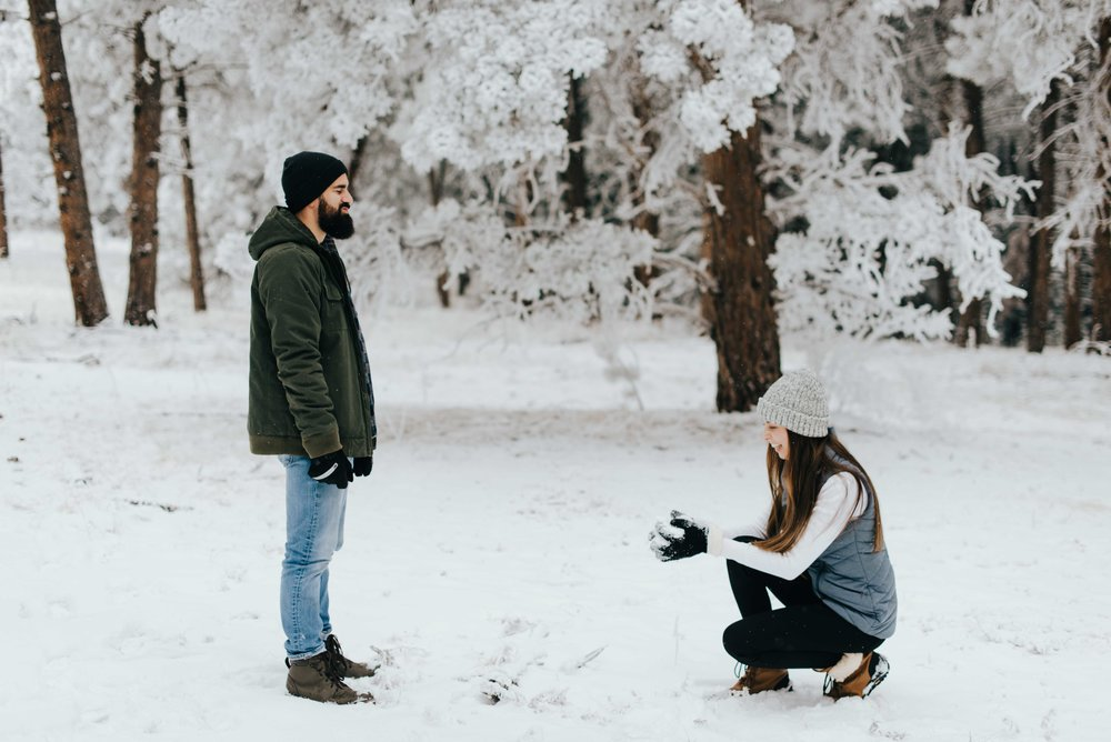 Nik and Tani before their snowball fight. They were looking forward to this ever since they found out it would be snowing during their mountain engagement session!