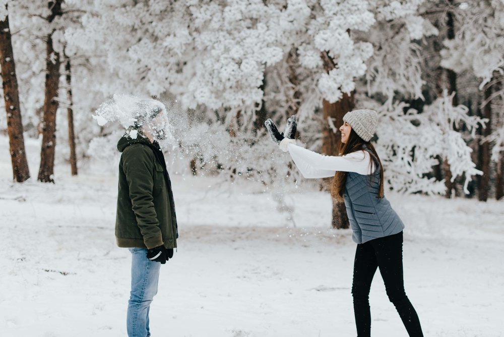 Nik receiving a face full of snow thanks to Tani's amazing snowball fighting skills! They had an epic snowball fight during their Colorado mountain engagement session!