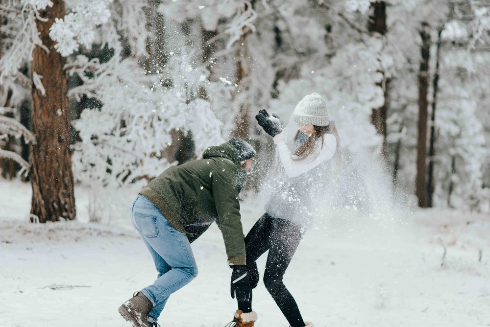 Nik and Tani battling it out during their snowy engagement session outside of Denver, Colorado.