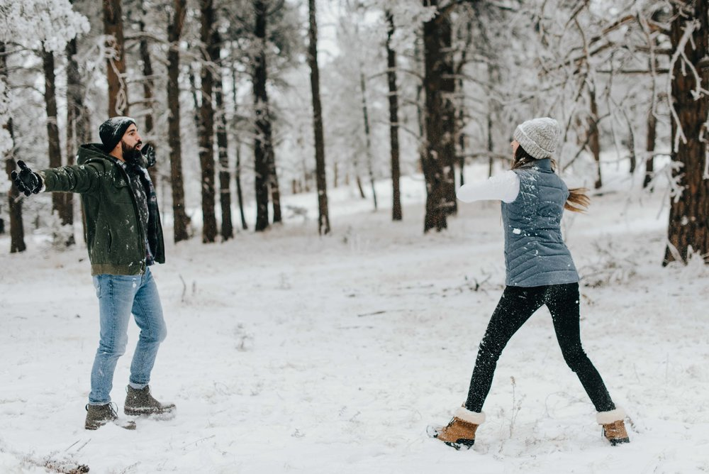 Nik challenging Tani during their snowball fight. They decided to have their engagement session on a snowy day in Golden, Colorado.