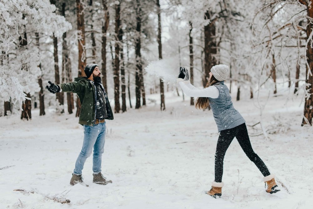 Nik and Tani, back at their epic snow fight during their adventure couples session in Colorado.