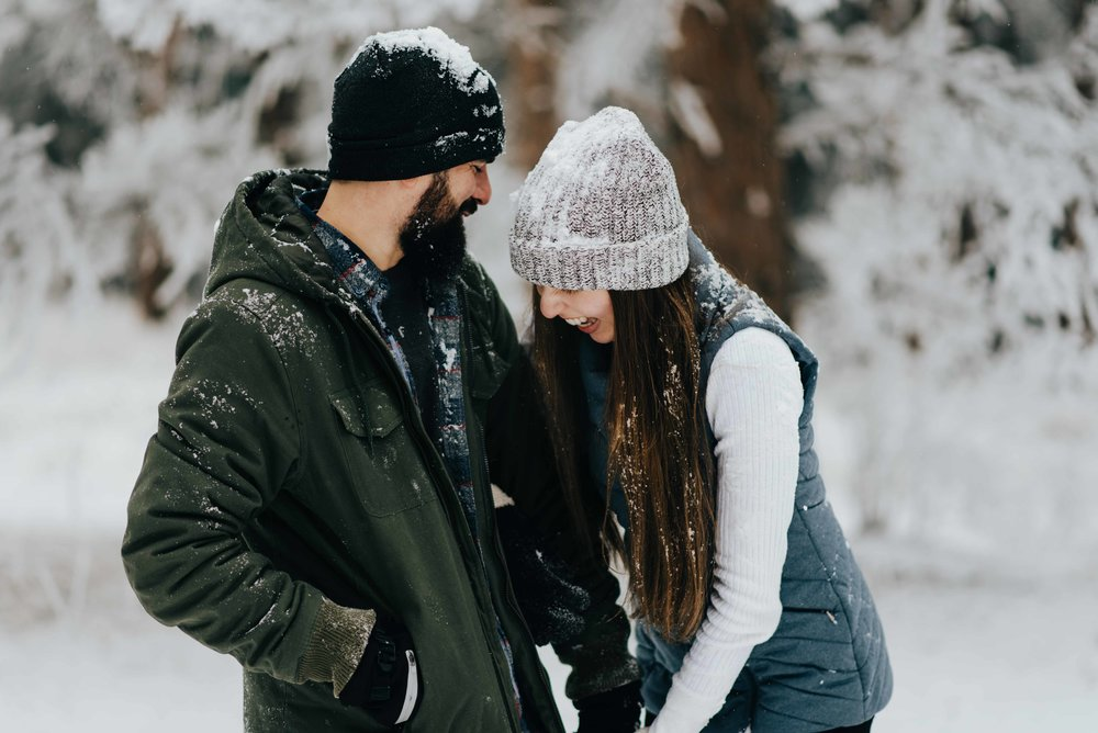 Nik and Tani full of snow during their mountain engagement session.