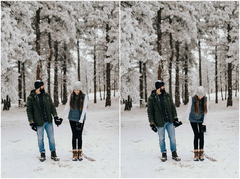 Nik and Tani standing side by side during their snowy mountain engagement session in Golden, Colorado.