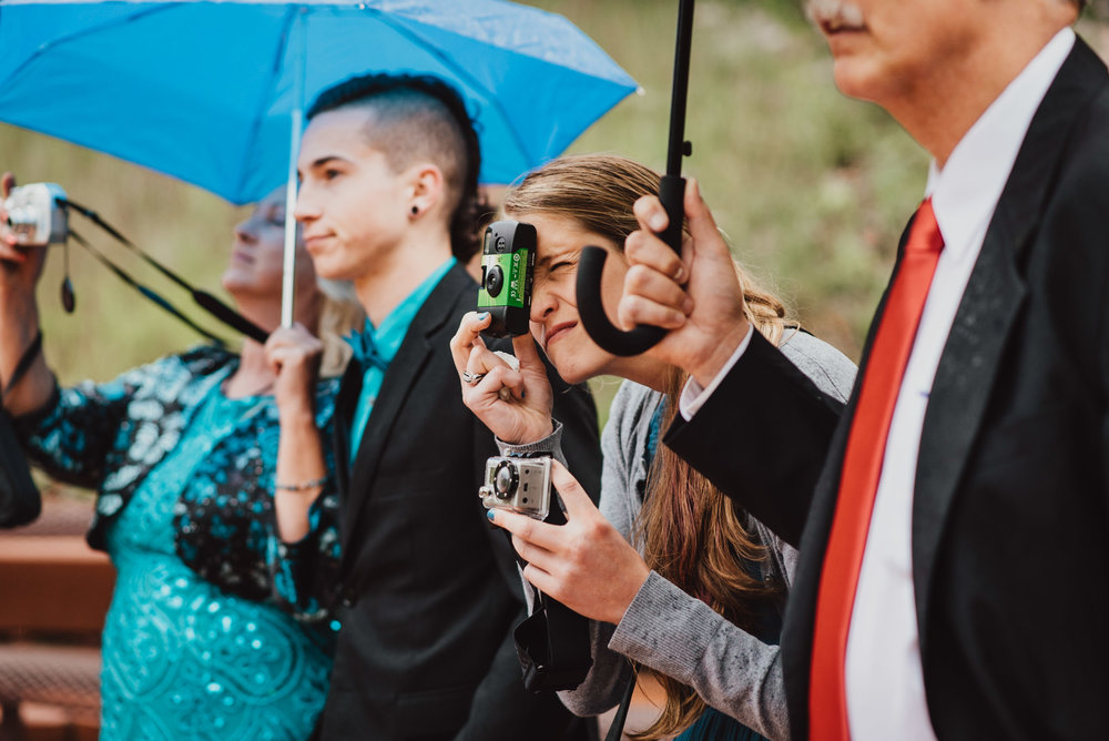 A guest using a disposable camera.