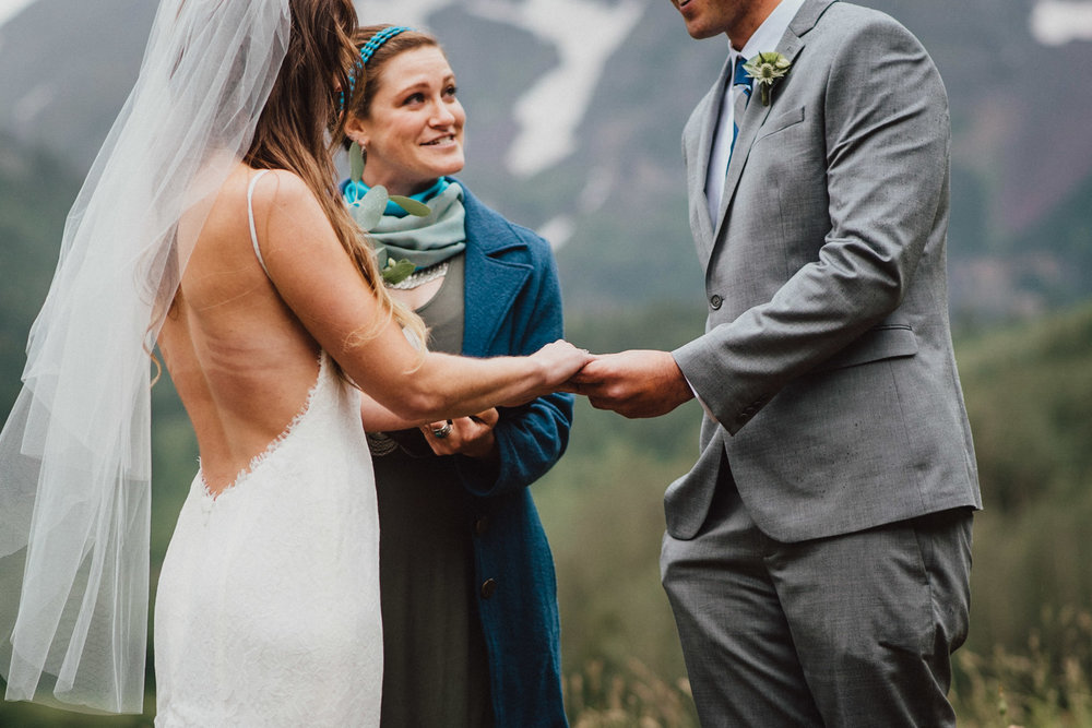 Heather and Darren exchanging rings at the Maroon Bells.