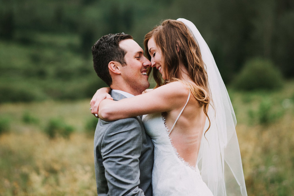 Heather and Darren embracing during their rainy day ceremony.