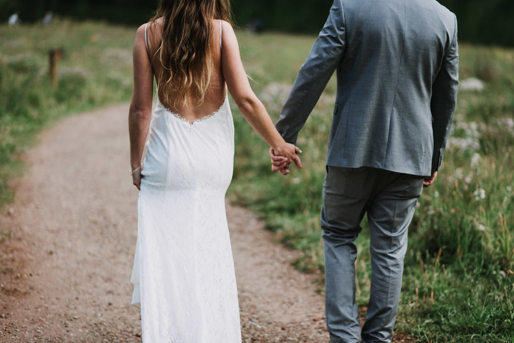 Heather and Darren holding hands during their Maroon Bells Elopement.
