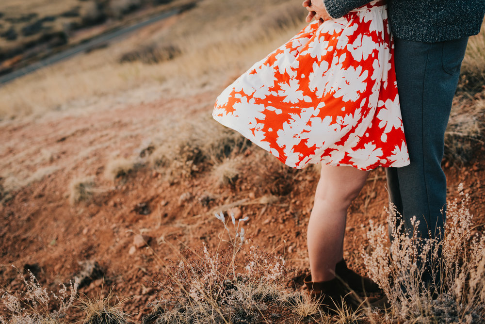 Rachels flowery sundress flowing in the wind during her and Ted's Colorado engagement session.
