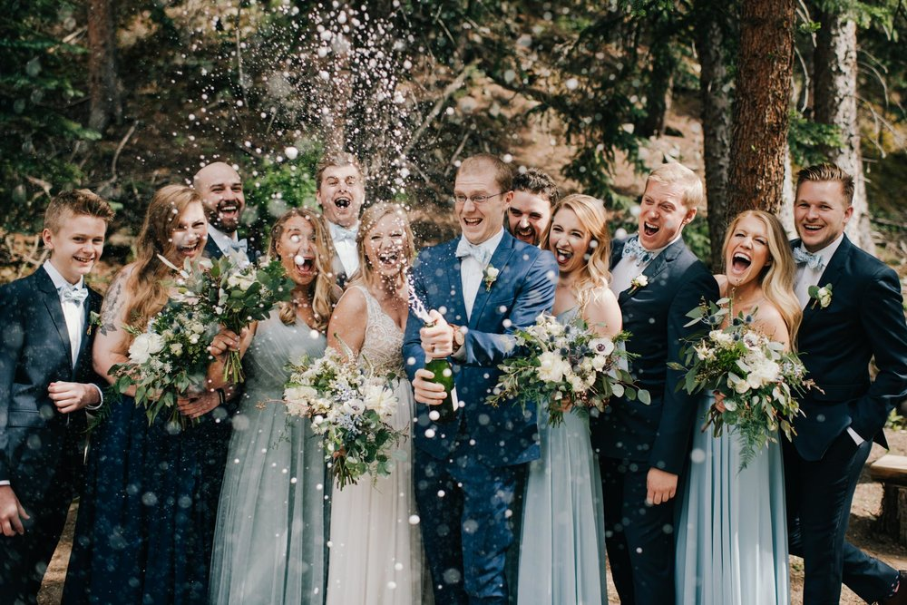 blackstone-rivers-ranch-wedding-blackstone-rivers-ranch-wedding-party-bridal-party-popping-champagne-group-photos