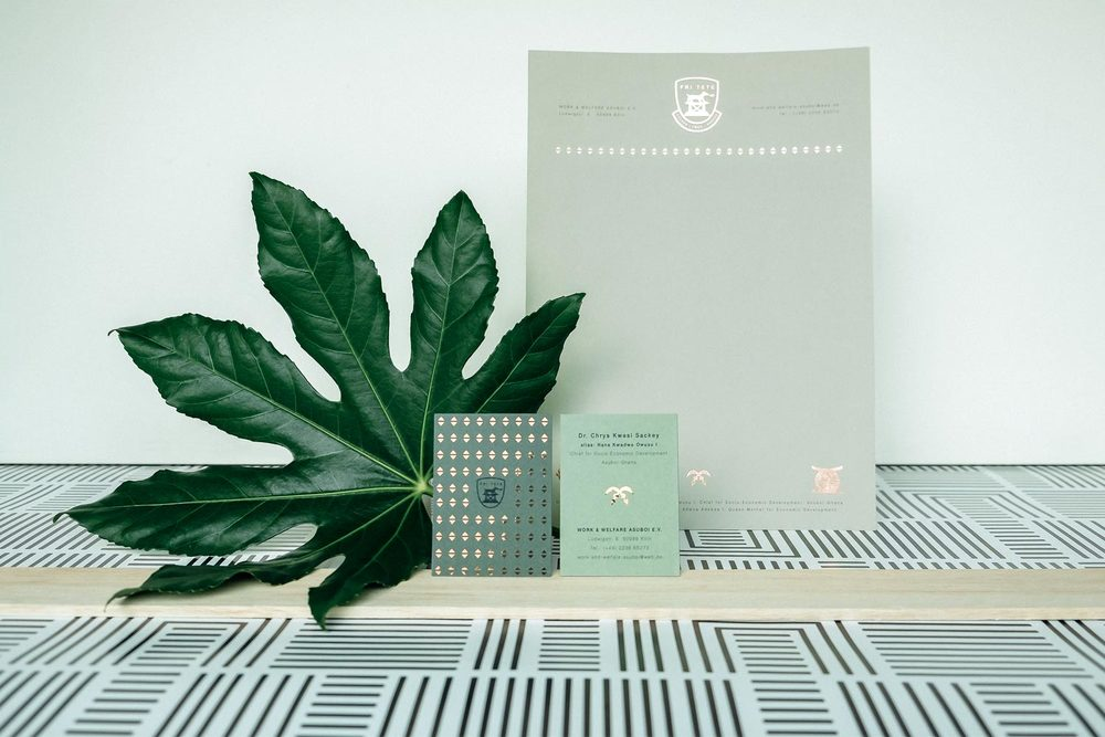 Design green stationary with business cards and a letterhead with copper foil embossing, icons and a leaf