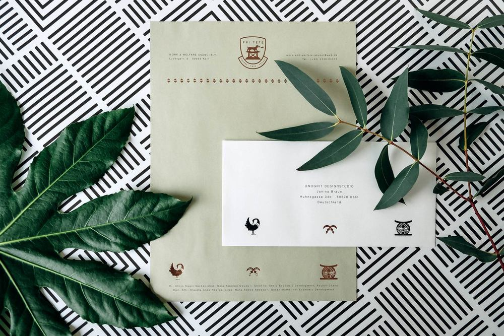 Design green stationary with a letterhead, an envelope with copper foil embossing, icons and leaves