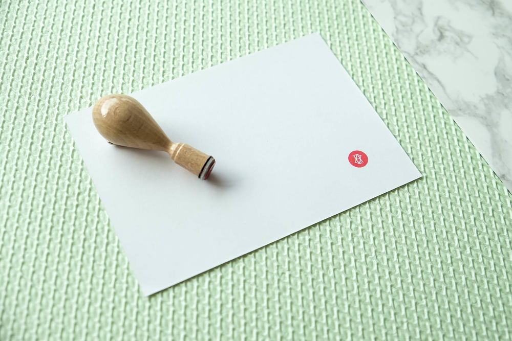 Hanko stamp and greeting card on green textured surface