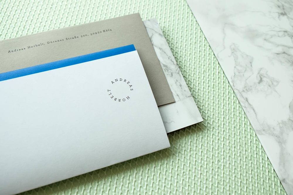 Letterhead with stamp and envelope on marble