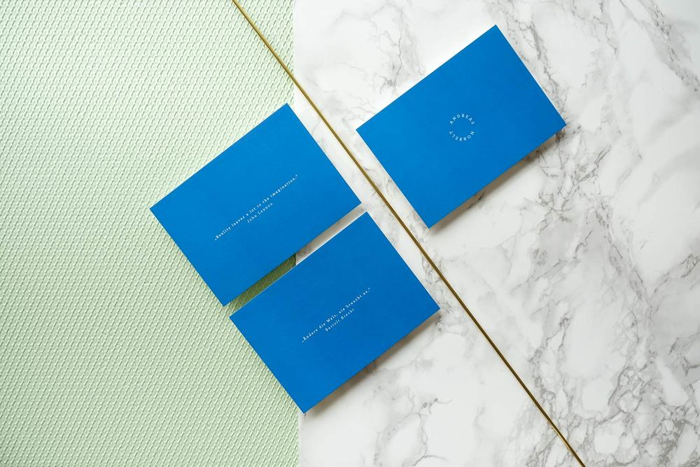 Blue greeting cards on marble