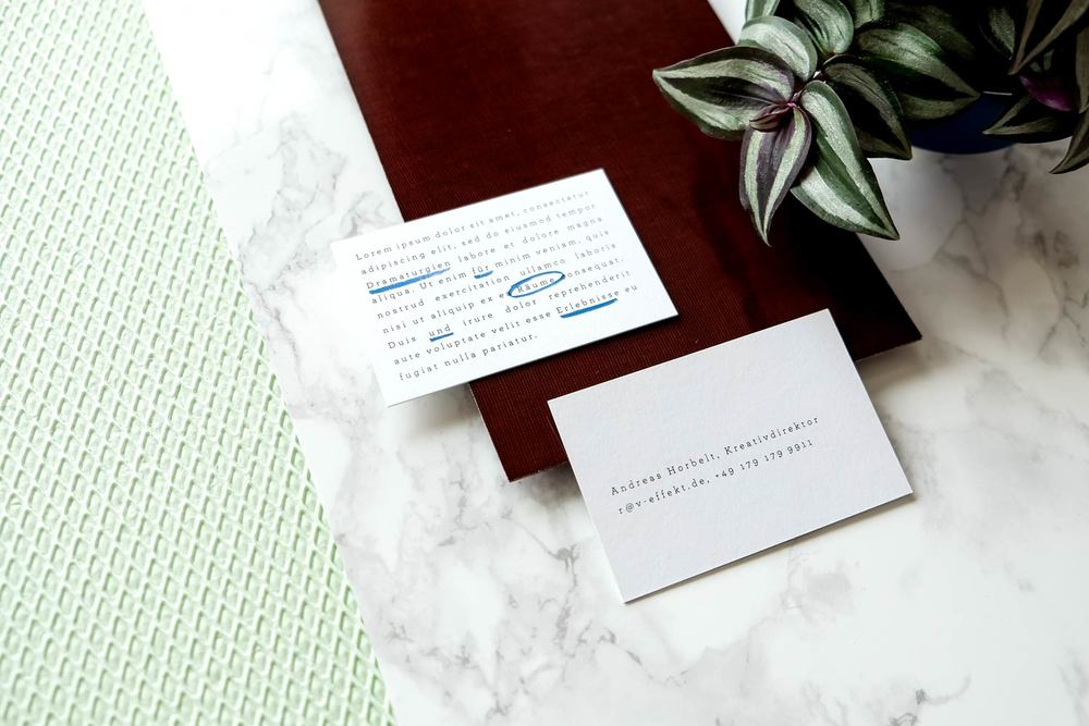 Business cards with plant on marble