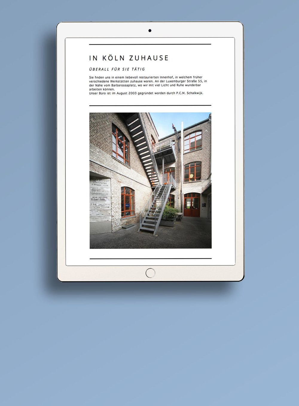 Responsive architecture website on a white iPad on a blue background