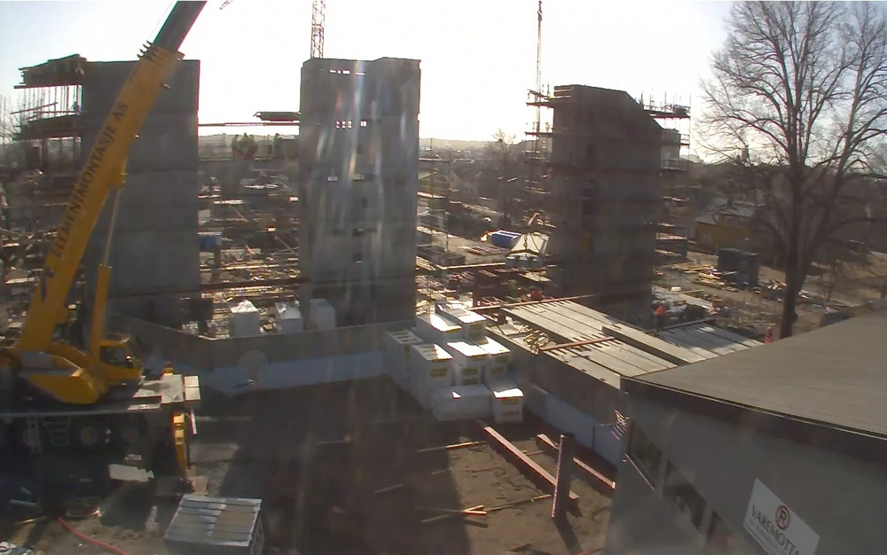Webcam image of the prefab concrete being lifted into place on site.