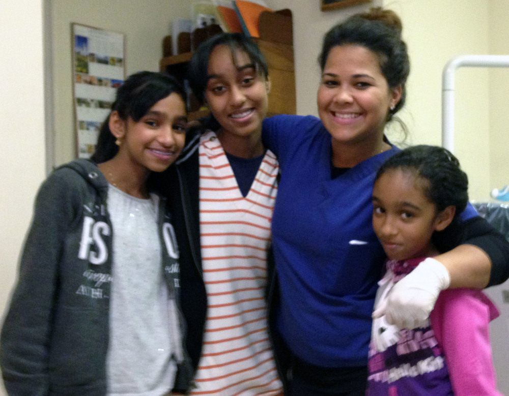 forest hills orthodontics staff with three patients