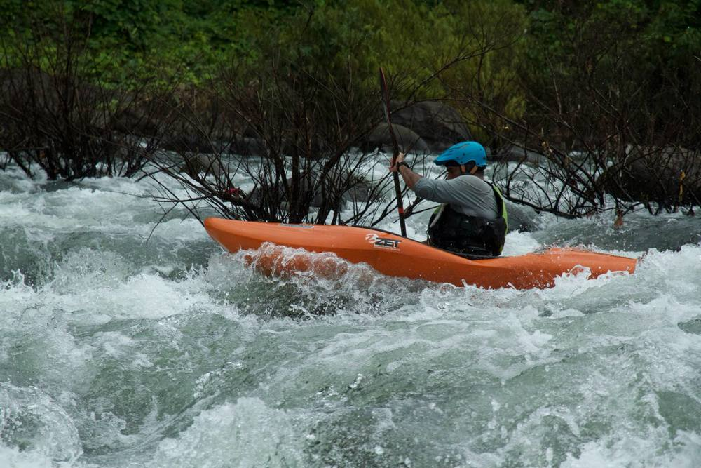 Kayak Instructor Manik, paddling down the Malabar Pool Rapid.