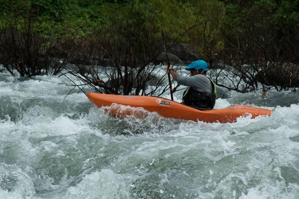 Kayak Instructor Manik, paddling down the Malabar Pool Rapid.