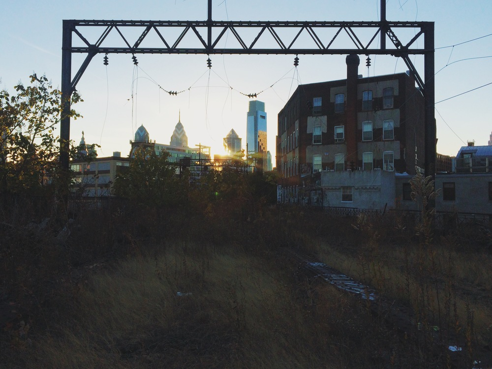 A photo of the Reading Viaduct overlooking Center City at sunset.