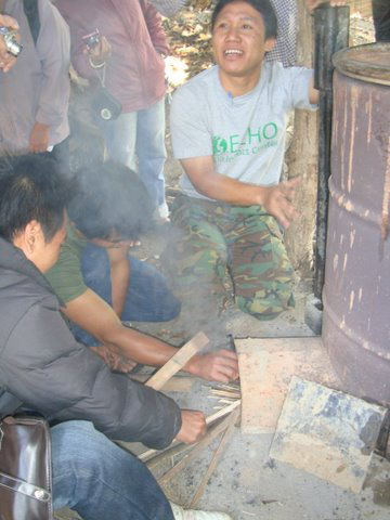Learning to produce charcoal and wood vinegar in a 200 litre drum - Trop Ag CM 2012_web.jpg