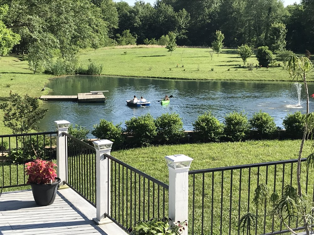 Our view (from the back porch) of the boys playing in the lake at Thurman Landing.