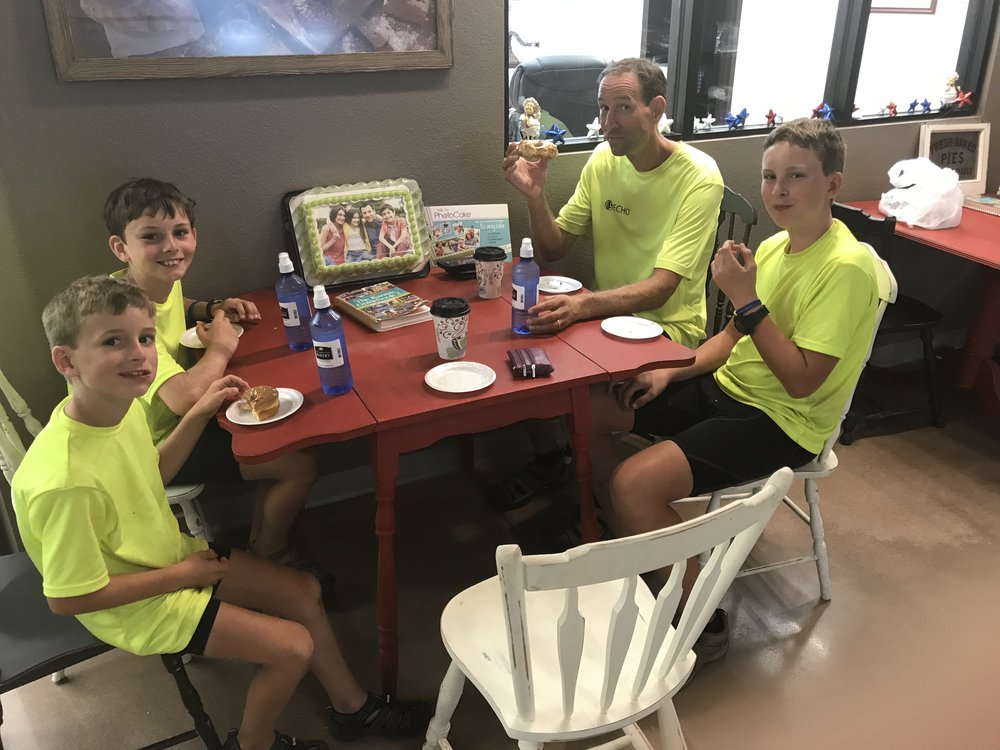 And here we are inside the bakery enjoying some fresh-out-of-the-oven doughnuts. Great pedal power food and a very fun and unexpected treat!