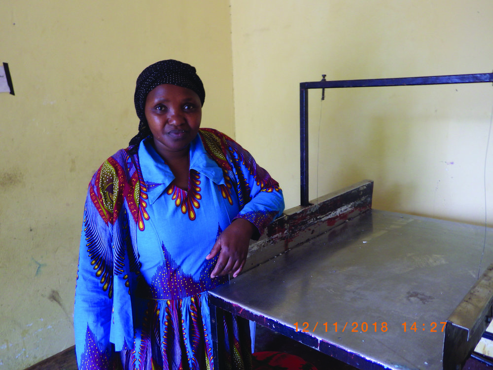 Magreth and her soap cutter made possible through ECHO and MIT's Micro-grant program.
