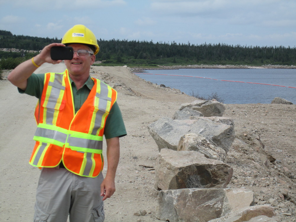 Rene Aucoin, President of the Cheticamp River Salmon Association, on a tour at the Wreck Cove facility