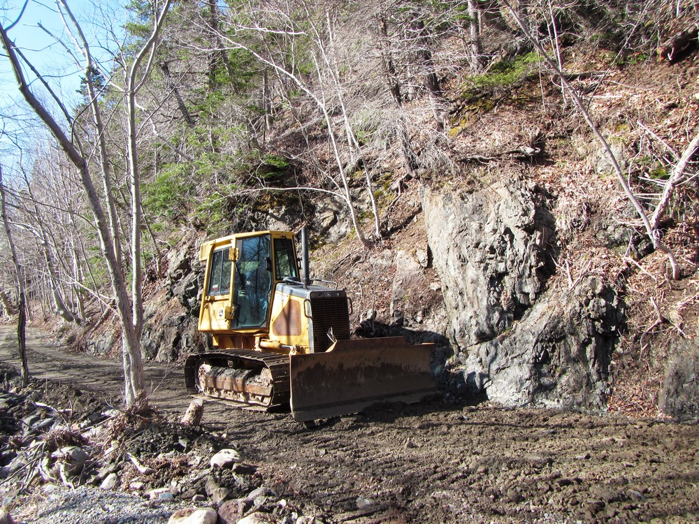 Bulldozer working to smooth the surface on the Salmon Pools trail