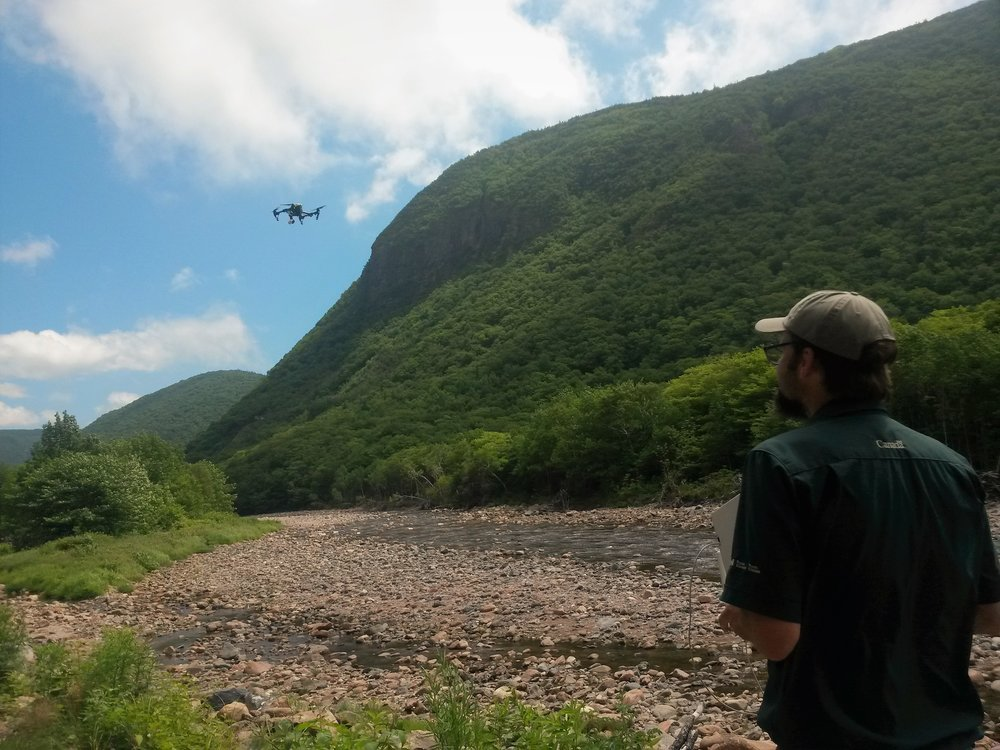 Geomatics Technician Michée Lemieuxwith CBHNP flies a drone over project work sites prior to the start of instream work.