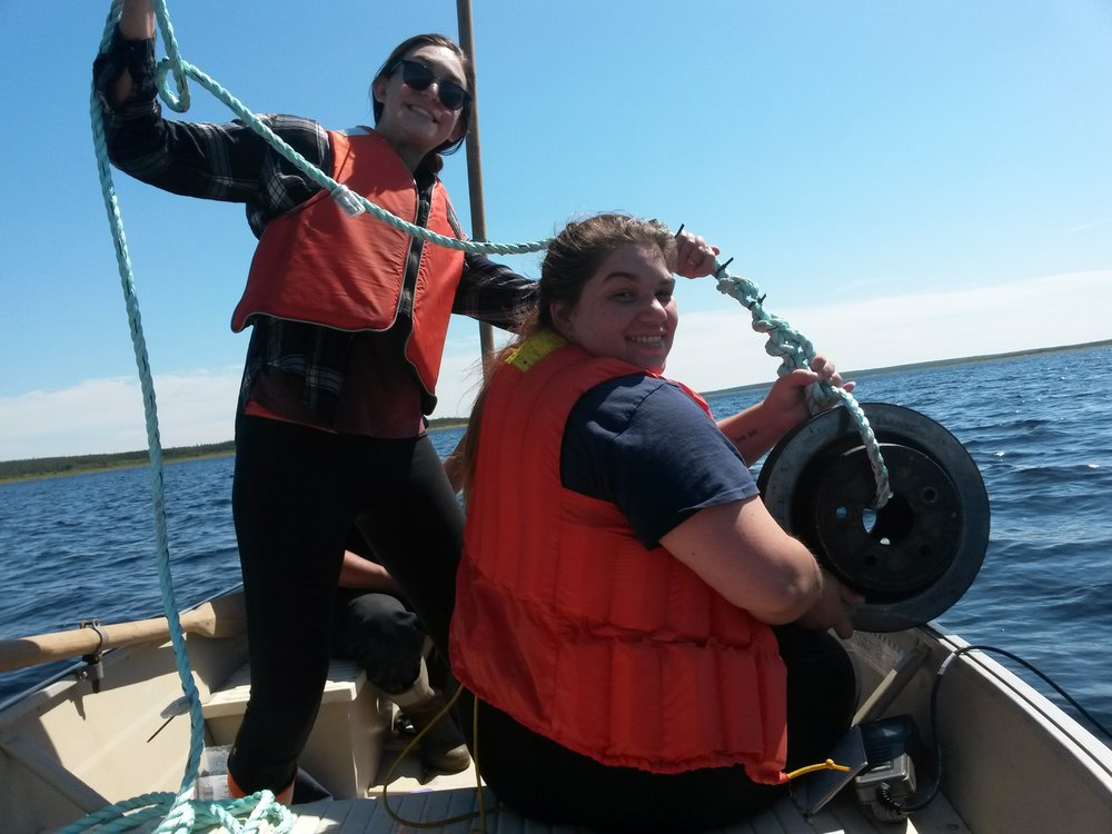 Gabrielle MacLaughlin and Kayla Blackwood - crew supervisor for CRSA's Habitat Restoration Crew - deploying temperature loggers at Cheticamp reservoir. Thanks to DFO for providing access to a boat and operator for this part of our project.