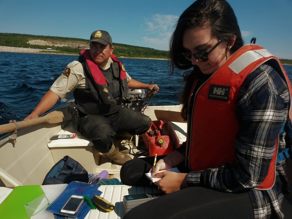 Last year's Field Technician, Gabrielle McLaughlin, recording water temperature data on a trip to the Cheticamp reservoir.