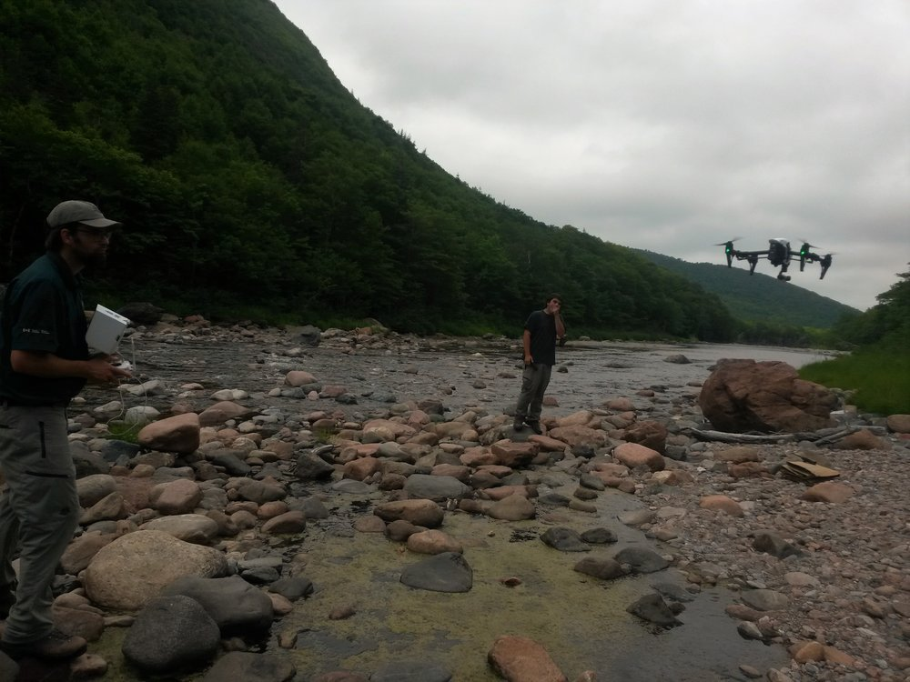 Parks Canada staff flying a drone last summer to help us to collect before and after photos and videos at our work sites on the lower Cheticamp River.