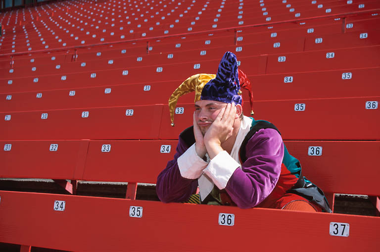 bored-jester-in-empty-stadium-uid