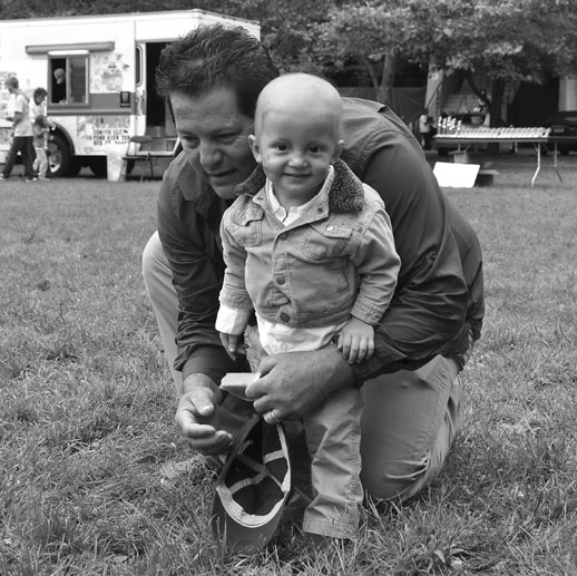 Kevin and his dad Sergio play on the lawn at Family Day 2012