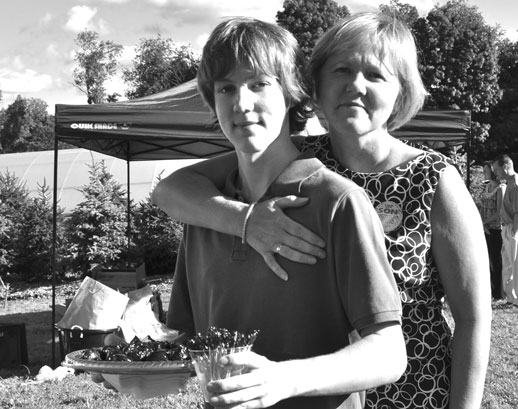 Chair Lisa Pollock and son Zach, who was a waiter at the wine tasting event.