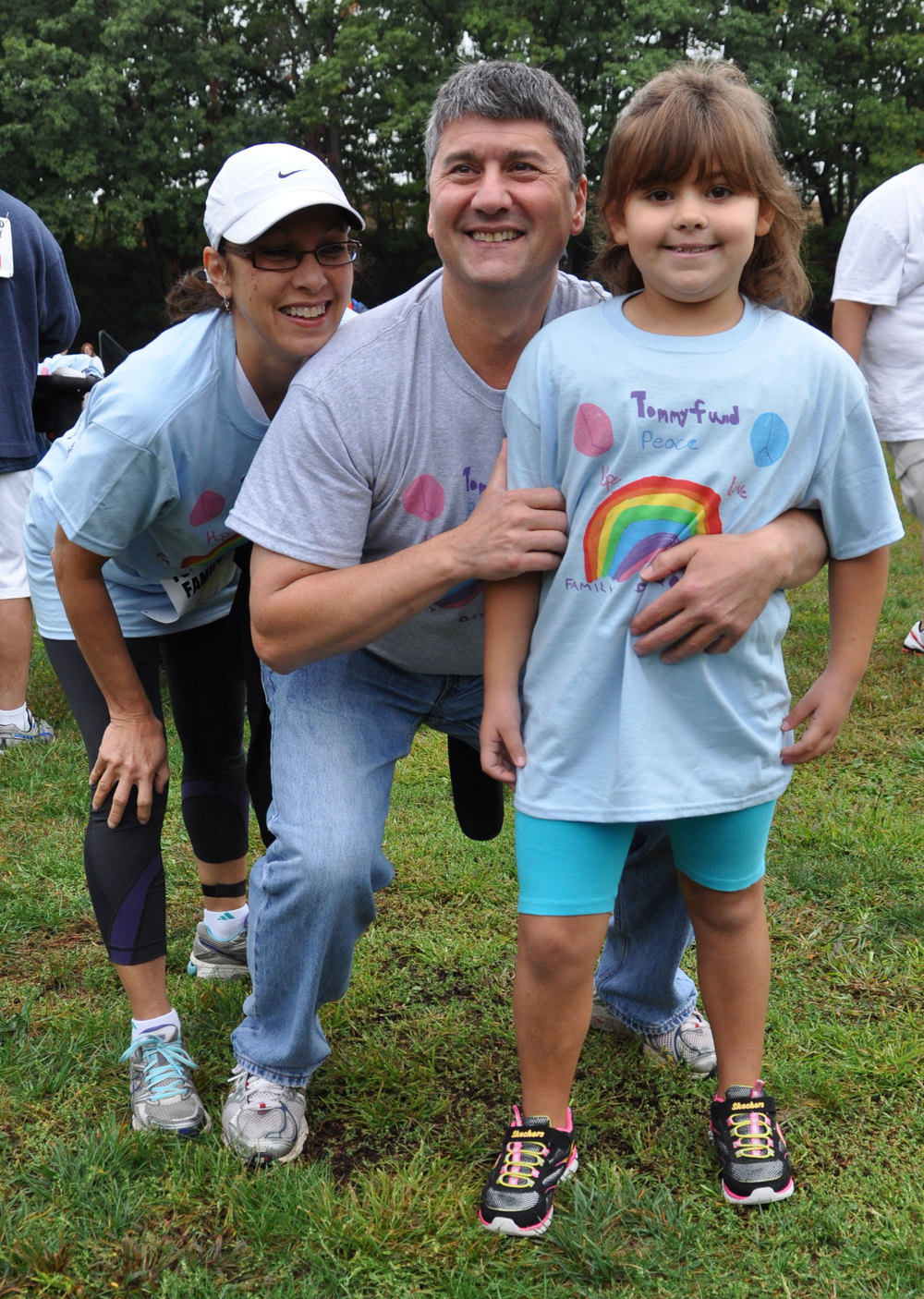 Abby Zodl, the artist who designed the Family Day t-shirt, shares a laugh with Tommy Fund president Peter Parente and Donna Parente, a nurse at Smilow Cancer Hospital at Yale-New Haven.