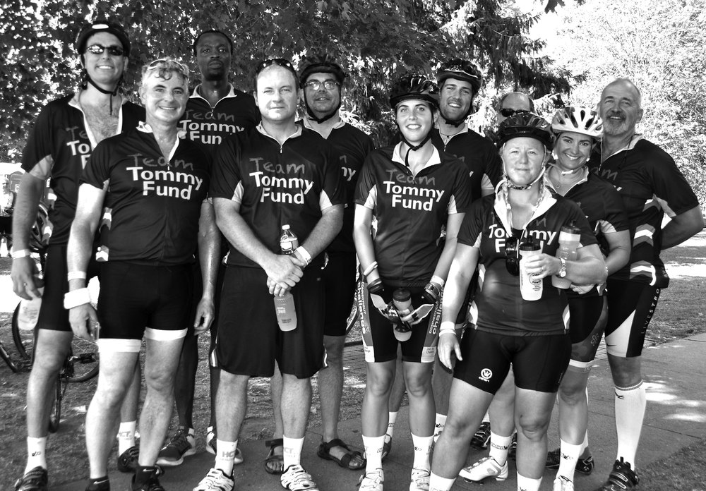 Team Tommy Fund riders gathered on the Guilford green for a water break. Though not all are pictured here, the team included: Mike Smith, Helen Williams, Jeremy Soboleski, K. Ayme Soboleski, Gary Kupfer, MD, Kalman Watsky, MD, Bayo Afolalu, Stephen Sirico, Madeline Guth, Kevin Guth, Howard Reiter, Marc Auerbach, MD, Antonio Scotto, Sean Thomas, Caitlin Smith, David Homer, Peter Smith, Andrew Bottinick, Jamie Bruce.