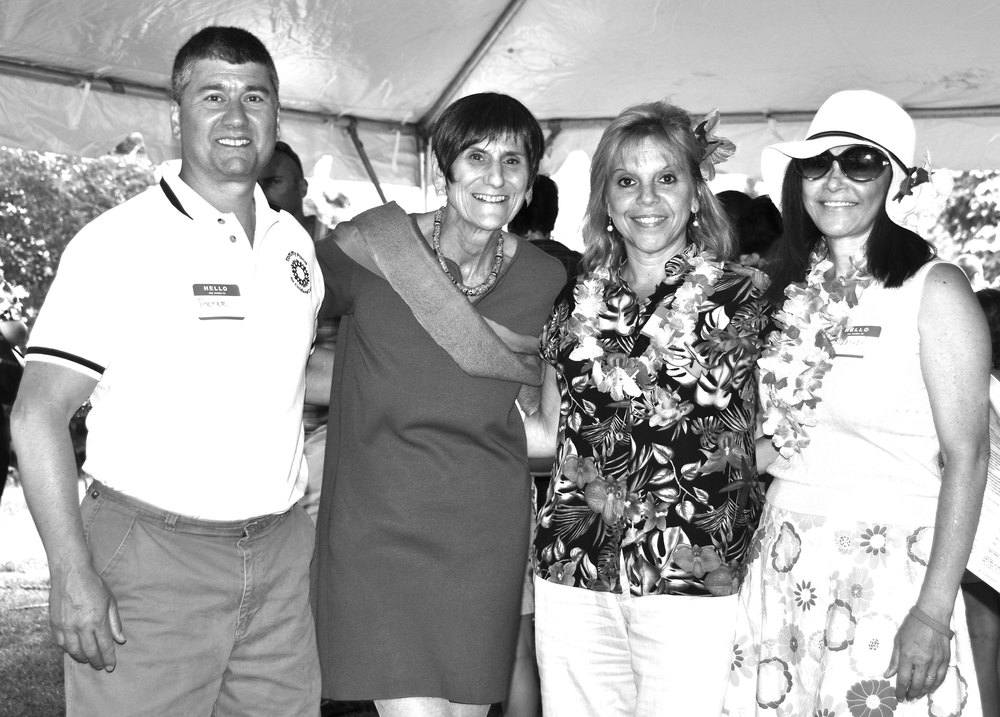 Tommy Fund president Peter Parente visits with U.S. Rep. Rosa DeLauro, oncology nurse Denise Carr, RN and social worker Marisol Lassalle, LCSW at the Let's Luau Survivor Day event.
